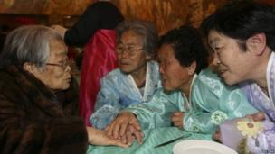 South Korean Kim Sung-yun (L), 96, talks with her North Korean sister Kim Seok-ryeo (2nd L), 80, and family members during their family reunion at the Mount Kumgang resort in North Korea on 20 February 2014