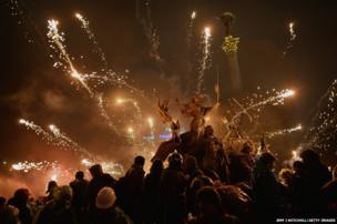 Anti-government protesters let off fireworks during demonstrations in Independence Square in Kiev, Ukraine