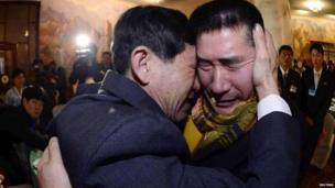 South Korean Park Yang-gon (R), 53, and his North Korean brother Park Yang-su, who was abducted by North Korea, cry during their family reunion at the Mount Kumgang resort in North Korea on 20 February 2014
