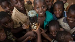 Children with the Queen's baton at the Batik Centre Mtandire, near Lilongwe, Malawi.