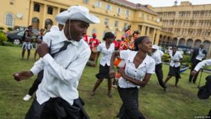 Dancers from Lusaka Secondary School Cultural Group perform in honour of the Queen's baton at the Cabinet Office in Lusaka, Zambia