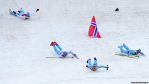 Norway's gold medalists Magnus Hovdal Moan, Magnus Krog, Haavard Klemetsen and Joergen Graabak celebrate