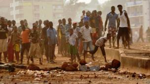 A crowd of youths in Guinea throwing stones in a street of Conakry, Guinea - Tuesday 18 February 2014