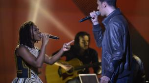 L: Nigerian singer Asa with with French slam poet Grand Corps Malade on stage at the Zenith concert hall in Paris, France - Friday 14 February 2014