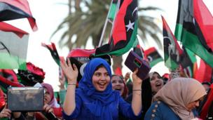 A crowd of women in Tripoli's Martyrs Square celebrating with flags, Libya - Monday 17 February 2014