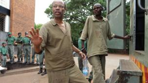 Mel Reynolds, a former US Congressman, handcuffed and in prison clothes in Harare, Zimbabwe - Thursday 20 February 2014