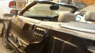 The fibre glass body of a car at Godfrey Namunye's garage in Kampala, Uganda