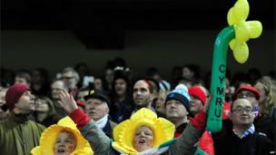 Wales fans cheer before the start of the Six Nations international rugby union match between Wales and France at the Millennium Stadium in Cardiff