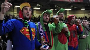 Getting into the mood -French fans in onesies