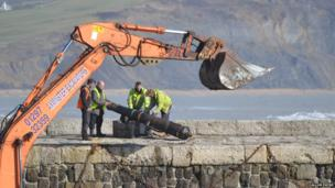 Canons on the sea wall at Lyme Regis being restored. Photo: Callum Payne