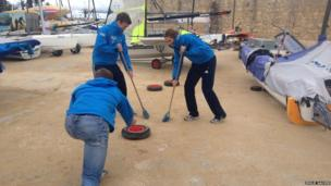 Members of the British sailing team set up a game of curling. Photo: Emilie Sauven