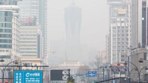 A smog hangs over the business area on 23 February 2014 in Hangzhou, China