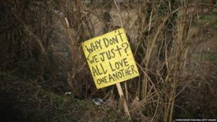 A sign placed by anti-fracking campaigners lies next to the road near the Igas Barton Moss exploration facility in England