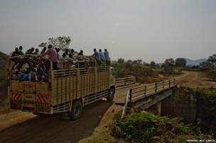 The truck carrying South Sudanese refugees, including Matiop and his family, crosses a bridge before reaching Dzaipi transit centre.