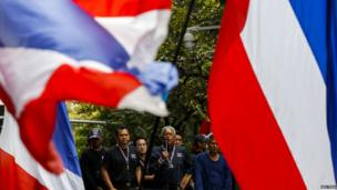 Anti-government protest leader Suthep Thaugsuban (centre) speaks as he leads anti-government protesters during a rally outside the Royal Thai Police headquarters in central Bangkok on 26 February