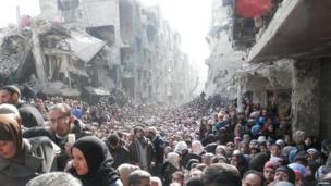 Huge crowds of desperate refugees at the Yarmouk Palestinian refugee camp near Damascus, taken on 31 January but released on Wednesday