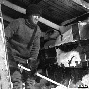 Xavier Mertz clears snow at base camp