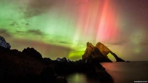 The Northern Lights seen at Bow Fiddle Rock in Portknockie, Moray, Scotland