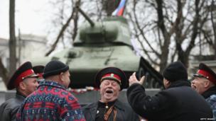 Pro-Russian Cossack demonstrators gather outside Crimean regional parliament, Simferopol (28 Feb)
