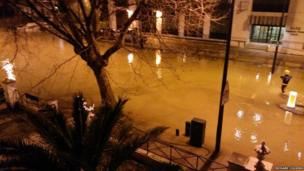 A burst water main in Clapham, London on Thursday night causes water to flood the main road