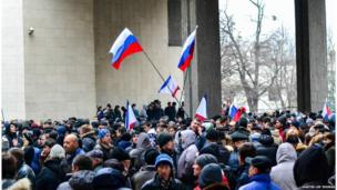 Hundreds of protesters gather outside the parliament building in the Simferopol centre, Crimea.