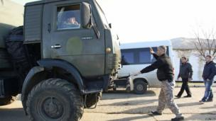 Pro-Russian residents from the village of Perevalnoye - outside Simferopol - attempt to stop Ukrainian servicemen driving a supply-carrying truck near the territory