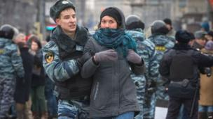 A police officer detains a protester in central Manezhnaya Square in Moscow, 2 March, 2014, during an unsanctioned rally against the Russia's military actions in Crimea