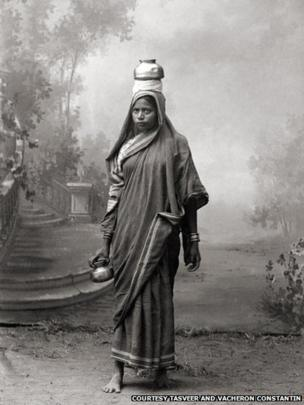 A woman carrying a pot, 1870