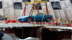 One of eight Chevrolet Corvettes is removed from a sinkhole in the Skydome at the National Corvette Museum
