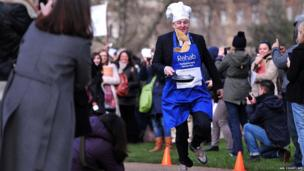 Lord Redesdale takes part in the annual parliamentary pancake race on Shrove Tuesday in central London