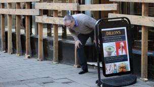 Customer leaving a shop in Ashbourne