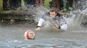Player swims to grab the ball