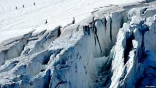 Walkers avoiding crevasses on the Stein glacier in Switzerland