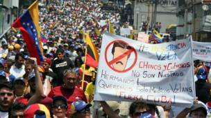 Opposition activists march during a protest against the government of Venezuelan President Nicolas Maduro in San Cristobal on 5 March, 2014.