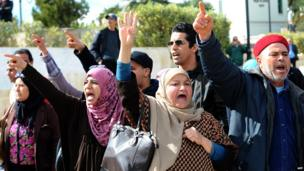 Supporters of Tunisia's Ennahdha party shout slogans during a demonstration