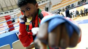 A Libyan boxer poses with his medal in the eastern city of Benghazi