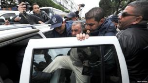 Algerian police arrest a demonstrator in Algiers
