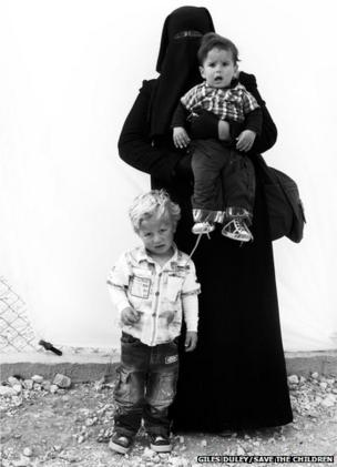 Suha 30, pictured with one year old Rami and Hadi age three