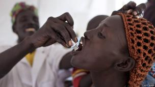 A woman is given a cholera vaccine at a medical camp run by the humanitarian organisation Doctors without Borders in Minkamman, South Sudan, on Monday.