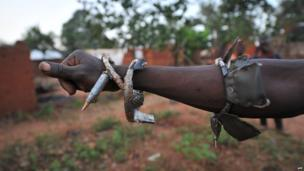 "A member of the ""anti-balaka"" Christian militia shows his charm bracelets in Boali, near Bangui, the capital of the Central African Republic"
