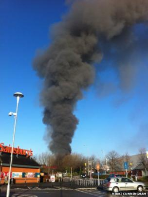 Plume of smoke from fire in Salford