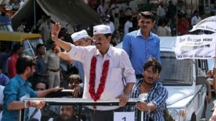Leader of Aam Aadmi Party, or Common Man Party, and anti-corruption activist Arvind Kejriwal, center, greet supporters during an election rally in Ahmadabad.