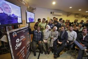 "Supporters of Narendra Modi, the prime ministerial candidate for BJP during a live video broadcast campaign on ""Talk over tea with Modi"", in the northern Indian city of Chandigarh."