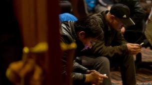 Relatives gather in Beijing, awaiting news of the Malaysia Airlines flight MH370