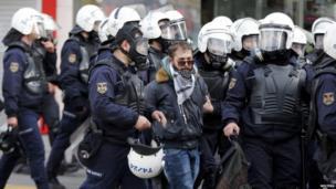 Riot police arrest a protester in Ankara (12 March 2014)