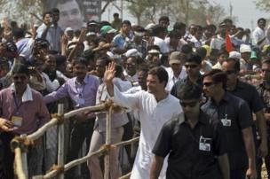 Rahul Gandhi of Congress party greets supporters during an election rally at Balasinor in the western Indian state of Gujarat.