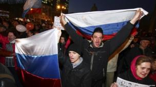 Pro-Russian demonstrators take part in a rally in Donetsk