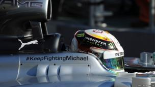"A message of support that reads ""#Keep Fighting Michael"" adorns the side of Mercedes driver Lewis Hamilton's car"