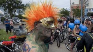An 81 year-old man gets ready to participate in the Naked Bike Ride in Cape Town, AFP