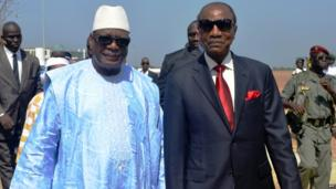 Guinea's President Alpha Conde, right, welcomes his Malian counterpart, Ibrahim Boubacar Keita, AFP